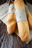 Fresh baguettes tied with kraft paper — Stock Photo