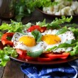 Fried eggs with herbs and paprika for breakfast — Stock Photo #33345399