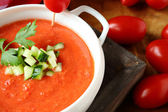 Delicious cold tomato soup with vegetables — Stock Photo