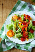 Healthy vegetable salad on plate, top view — Stock Photo