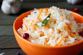 Delicious sauerkraut with garlic and cranberries — Stock Photo