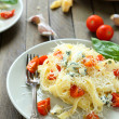 Pasta with brie cheese and roasted tomatoes — Stock Photo
