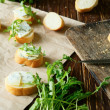 Baguette with cheese and herbs — Stock Photo