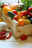 Vegetables and fruits in a wooden crate — Stock Photo