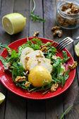 Crispy salad with pears and walnuts — Stock Photo