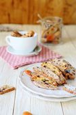 Homemade biscotti on a white plate and a cup — Stock Photo