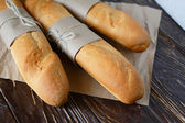 Baguettes on wrapping paper — Stock Photo