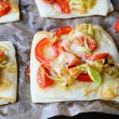 Square pizza with red pepper and onion leeks — Stock Photo