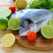 Two fresh sea bream fish on board — Foto de Stock