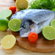 Two fresh sea bream fish on board — Stock Photo