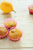 Pumpkin muffins on wooden table — Stock Photo