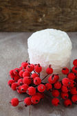 White Christmas candle and red rowan — Stock Photo