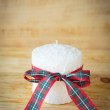beautiful white candle and Christmas ribbon — Stock Photo