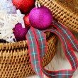 Christmas decorations in a round wicker basket — Stock Photo