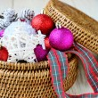 Background with Christmas decorations in a round wicker basket — Stock Photo