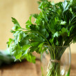 Bunch of green parsley in a transparent glass — Stock Photo