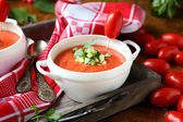 Tomato cream soup in a white tureen — Stock Photo