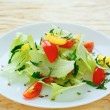 Fresh vegetable salad with iceberg lettuce — Stock Photo