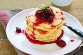 Stack of pancakes with raspberry jam — Stock Photo
