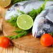 Raw fish and vegetables — Stock Photo