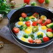 Fried eggs with vegetable mix — Stock Photo
