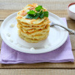 Stock Photo: Potato pancakes with sour cream