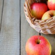 Fresh red and yellow apple and a basket — Stock Photo