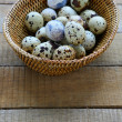 Quail eggs in a wicker basket — Stock Photo