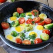 Vegetable fried eggs in a frying pan — Stock Photo #37040065