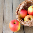 Fresh apples in the basket — Stock Photo