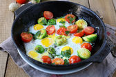 Vegetable fried eggs in a frying pan — Stock Photo