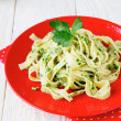 Tagliatelle pasta with pesto — Stock Photo