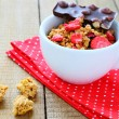 Granola with dried strawberries and chocolate — Stock Photo