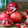 Rustic still life with pomegranates — Stock Photo #37867511