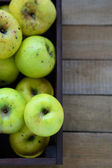 Household apples in wooden crate, top view — Stock Photo