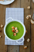 Green soup cream soup with croutons — Stock Photo