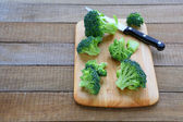 Broccoli florets on the kitchen board — Stock Photo