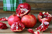 Rustic still life with pomegranates — Stock Photo