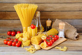 Still life with pasta and ingredients — Stock Photo
