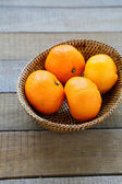 Whole tangerines in basket — Stock Photo