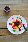 Pancakes with berry sauce — Stock Photo