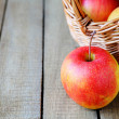 Apple near basket — Stock Photo #38075067