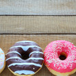 Stock Photo: Round donuts with colored glaze