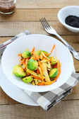 Roasted brussels sprouts with carrots — Stock Photo