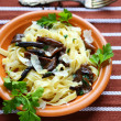 Pasta with parmesan cheese and mushrooms — Stock Photo
