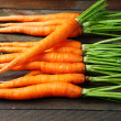 Stock Photo: Carrots with tops on table