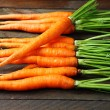 Carrots with tops on the table — Stock Photo #38326309