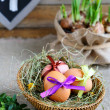 Easter still life with basket and flowers — Stock Photo