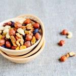 Mix nuts - walnuts, hazelnuts, almonds, raisins — Stock Photo #38374943