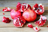 Ripe pomegranates loose on a table — Stock Photo